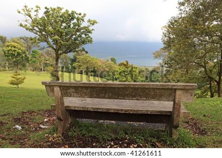 Old stone bench in solar park - stock photo