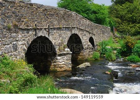 Old stone bridge in Dartmoor National Park, Devon, England - stock photo