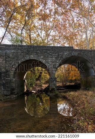 old stone bridge in fall