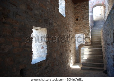 old stone castle gate with staircase and door to dungeons in an ancient style - light and darkness - stock photo