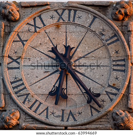 old stone clock - stock photo