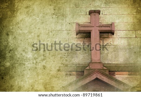 old stone cross on the wall in retro design with copyspace for text - stock photo