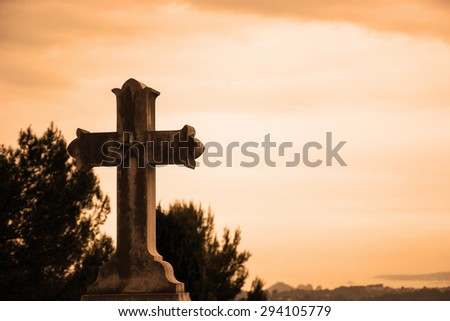 Old stone cross with star over the valley. Religion background. Retro toned photo. - stock photo