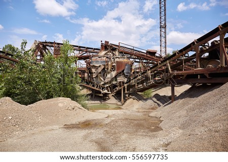 Old stone crushing plant. Gravel mill.