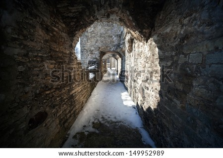 Old stone fortress dark stone tunnel perspective - stock photo