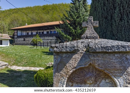 Old Stone fountain and church in  Temski monastery St. George, Pirot Region, Republic of Serbia - stock photo