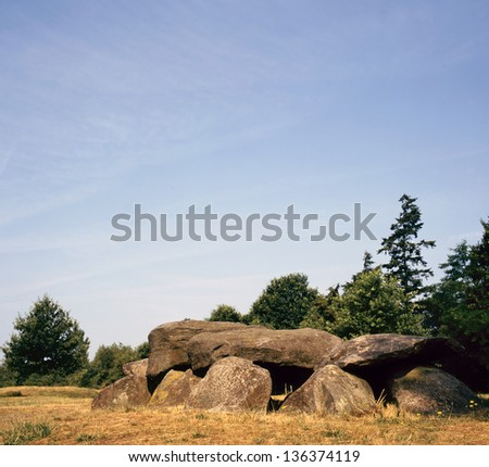 Old stone grave like a big dolmen in Drenthe Holland. It is called in Dutch a Hunnebed - stock photo