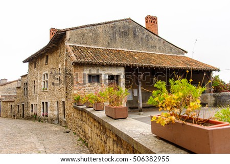 Old stone house in  Perouges, France, a medieval walled town, a popular touristic attraction.