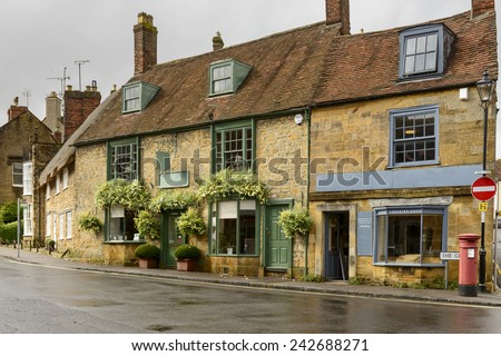 old stone houses at Sherborne, Dorset, view of  old houses  and street in the historic village  - stock photo