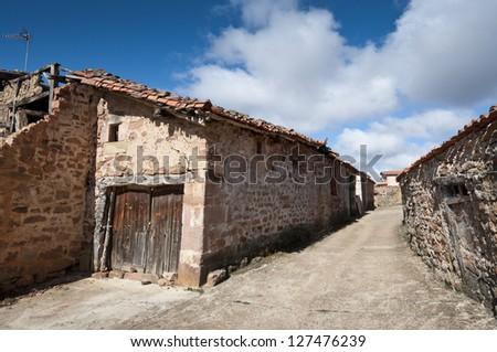 Old stone houses in San Millan de Lara, Burgos Province, Spain. - stock photo