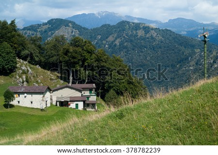 old stone houses photographed at Piani d'Erna (part of the Alps) near Lake Como in Italy - stock photo
