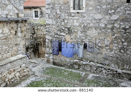 Old stone mediterranean houses and laundry on the line in Hvar, Croatia