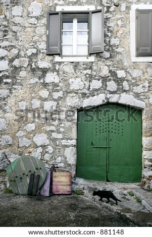 Old stone mediterranean street and green doors