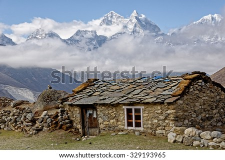 Old stone shed in mountains. Abandoned village in Himalayas. Trekking in Nepal - stock photo