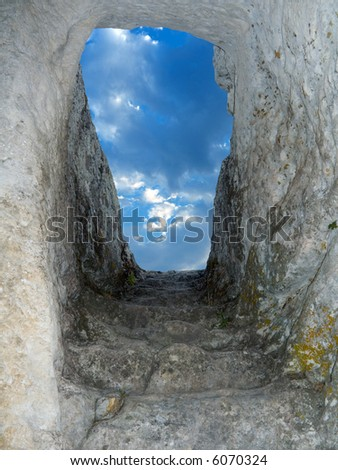 Old stone staircase from cave to sky - stock photo