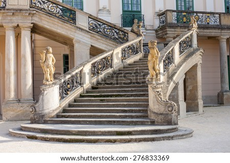 Old stone stairway of Esterhazy Castle with wrought iron banister and statues in Fertod, Hungary - stock photo