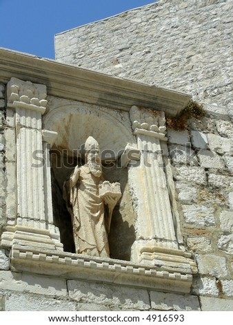 Old stone statue at the entrance of Old Dubrovnik. - stock photo