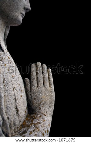 Old stone statuette - Praying. Isolated on black - stock photo
