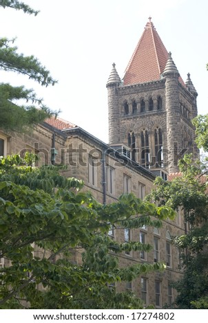 Old stone tower on the far end of a sandstone building. - stock photo