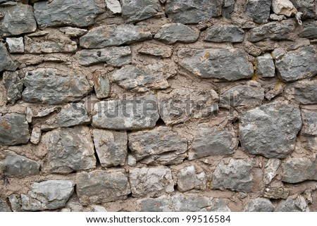 Old Stone Wall At The Foot Of A Medieval Castle