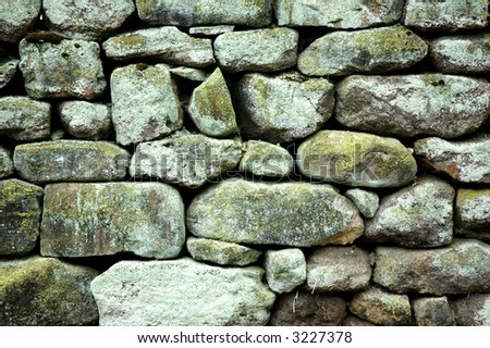 Old stone wall detail - stock photo