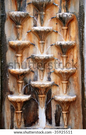 old stone wall rusty fountain texture outdoor - stock photo