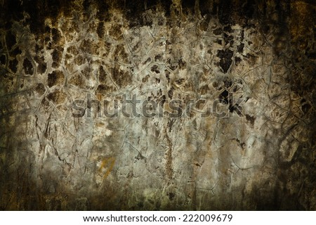 Old stone wall with cracks and patina - stock photo