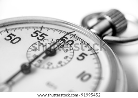 Old stopwatch closeup with selective focus. - stock photo
