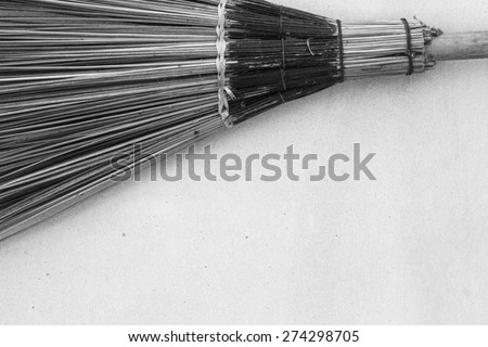 Old straw broomstick - stock photo