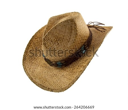 Old Straw Cowboy Hat with brown leather and stone headband isolated on white - stock photo