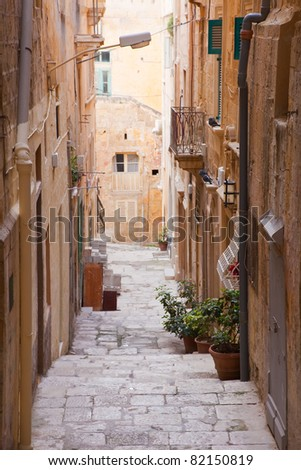 Old street  and picturesque houses of Valletta. Malta - stock photo