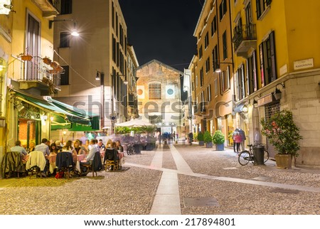 Old street in Milan at night, Italy - stock photo