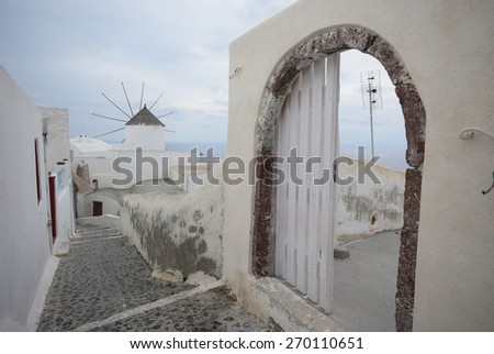 Old street in Oia on the island Santorini, Greece - stock photo