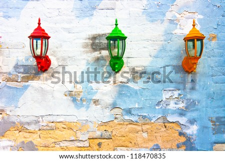 Old street lamp on a  wall background - stock photo