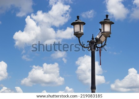 Old Street lamp on blue sky - stock photo