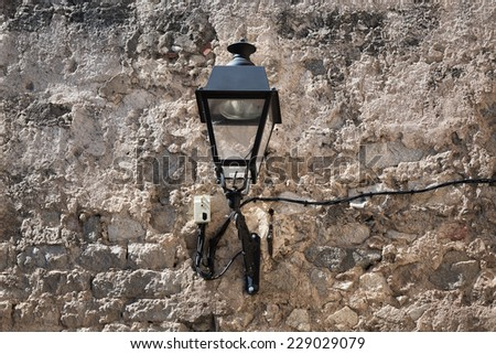 old street lamp on the wall - stock photo