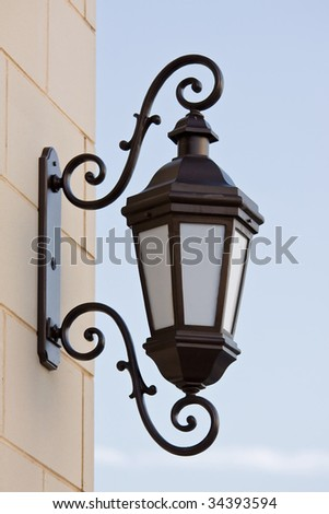 old street lantern over blue sky background - stock photo