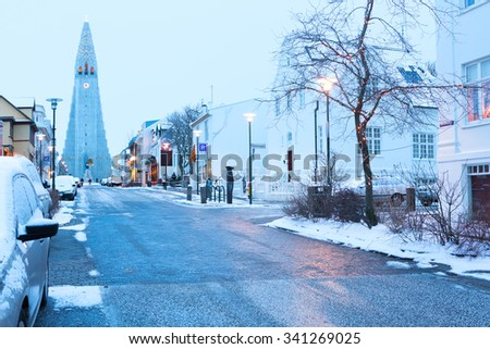 Old street of  downtown Reykjavik, Iceland.          in the background church of Hallgrimur