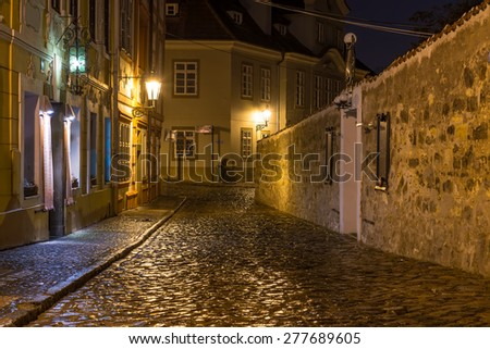 Old street of Hradcany district in Prague at night. Czech Republic - stock photo