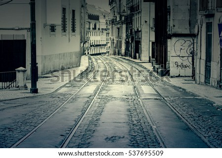 Old street of Lisbon, detail of an old area of ??the city, to tram routes in Portugal