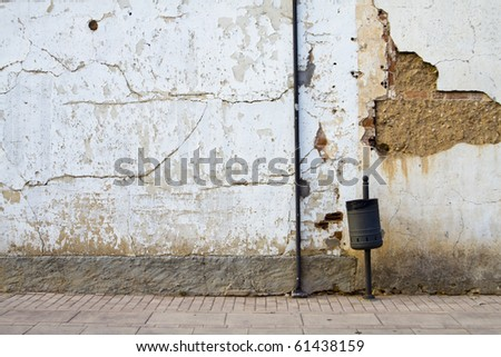 old street with rusty wall - stock photo