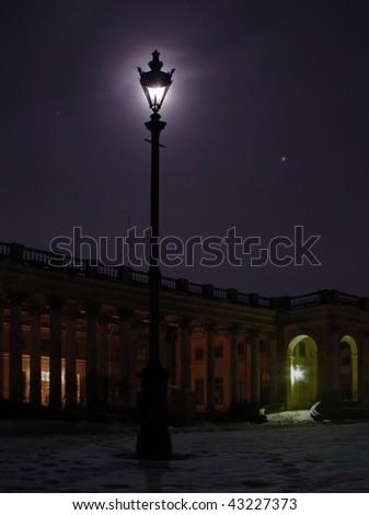 Old streetlight at night . Blue moon dark palace - stock photo