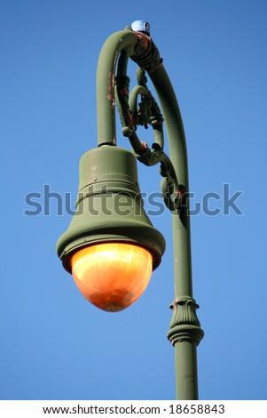 Old streetlight in Savannah Georgia's Historic District. - stock photo