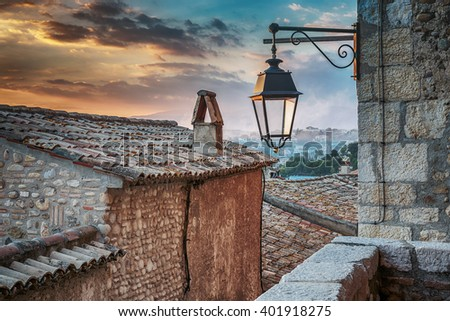 Old streetlight in the medieval village - stock photo