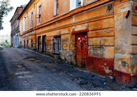 old streets and houses of the city grown old times - stock photo