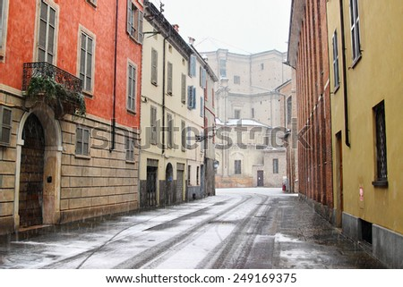Old streets in Italian town in winter, Parma, Italy - stock photo