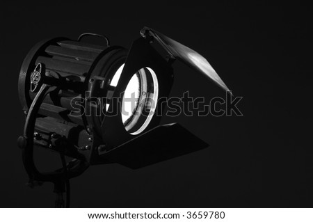 Old studio light on movie set with black background - stock photo