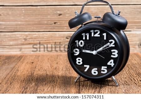 old style alarm clock - stock photo