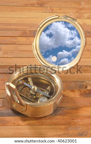 Old style brass compass on bamboo background - stock photo
