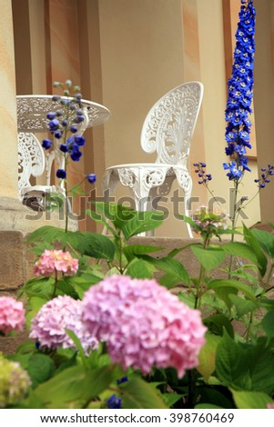 Old style chairs and table on the terrace of the castle - stock photo